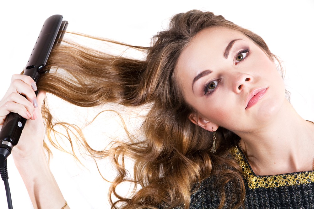 8 Flat Iron Mistakes That Are Damaging Your Hair